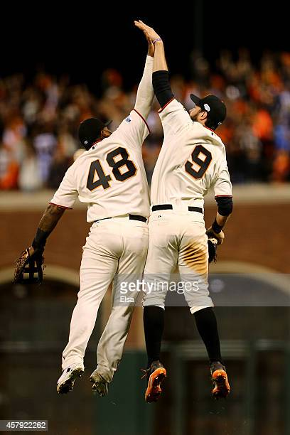 Pablo Sandoval and Brandon Belt of the San Francisco Giants celebrate after defeating the Kansas City Royals 50 in Game Five of the 2014 World Series...