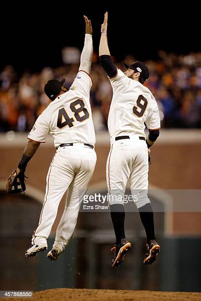 Pablo Sandoval and Hunter Pence of the San Francisco Giants celebrate the Giants 114 victory against the Kansas City Royals during Game Four of the...