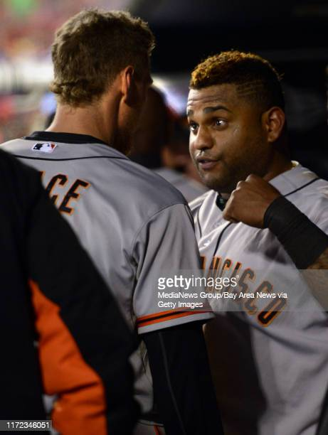Pablo Sandoval and Hunter Pence of the San Francisco Giants talk in the dugout during Game 5 of the National League Championship Series against the...