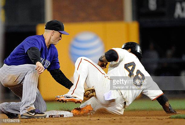 Pablo Sandoval is caught stealing tagged out by Mark Ellis of the Colorado Rockies in the sixth inning during an MLB baseball game at ATT Park on...