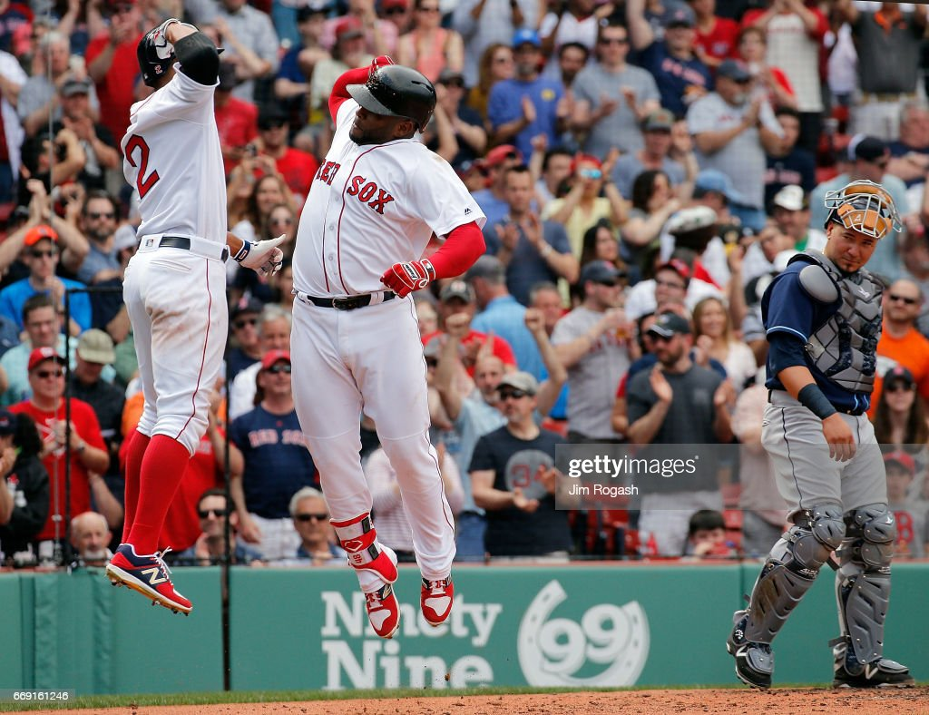 Pablo Sandoval #48 of the Boston Red Sox celebrates his two-run home run with Xander Bogaerts #2 of the Boston Red Sox against the Tampa Bay Rays in the fourth inning at Fenway Park on April 16, 2017 in Boston, Massachusetts.