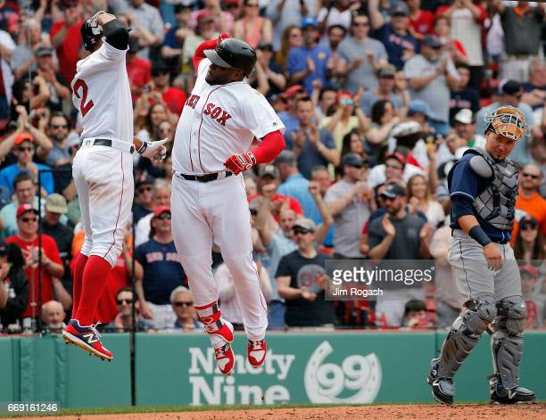 Pablo Sandoval of the Boston Red Sox celebrates his tworun home run with Xander Bogaerts of the Boston Red Sox against the Tampa Bay Rays in the...