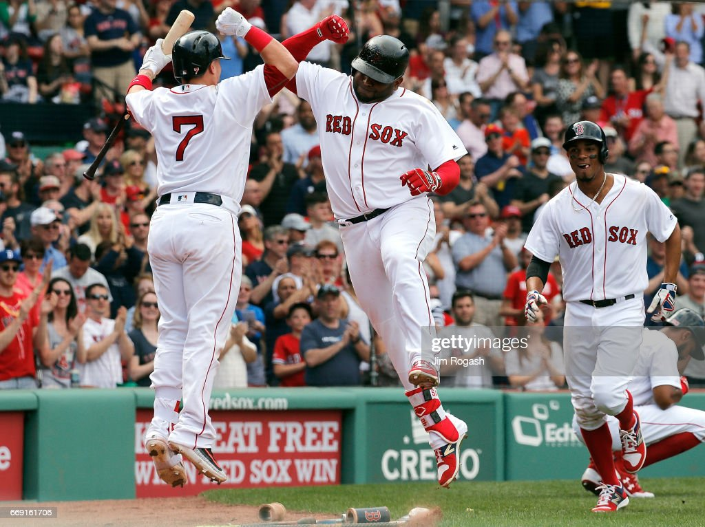Pablo Sandoval #48 of the Boston Red Sox celebrates his two-run home run with Christian Vazquez #7 of the Boston Red Sox against the Tampa Bay Rays in the fourth inning at Fenway Park on April 16, 2017 in Boston, Massachusetts.