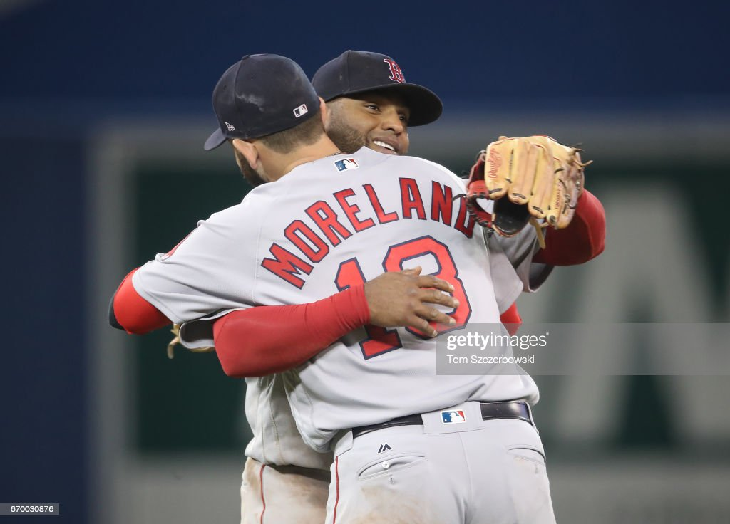 Pablo Sandoval #48 of the Boston Red Sox celebrates their victory with Mitch Moreland #18 during MLB game action against the Toronto Blue Jays at Rogers Centre on April 18, 2017 in Toronto, Canada.