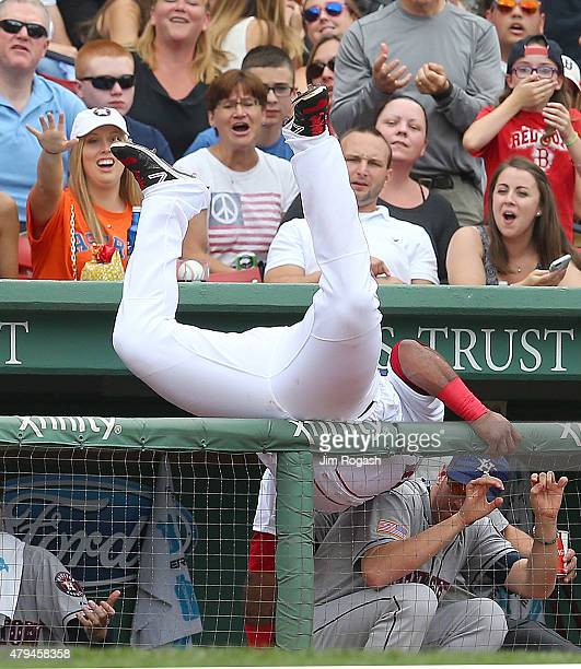 Pablo Sandoval of the Boston Red Sox falls in the Houston Astros dugout as he catches a ball hit by Alex Presley of the Houston Astros in the fourth...