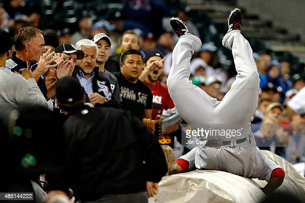 Pablo Sandoval of the Boston Red Sox leaps onto the tarp to make a catch for an out against the Chicago White Sox during the second inning at US...