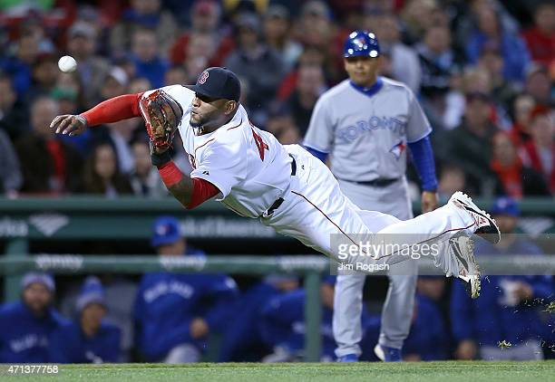 Pablo Sandoval of the Boston Red Sox makes a catch on a soft line drive off the bat Dalton Pompey of the Toronto Blue Jays in the fourth inning at...
