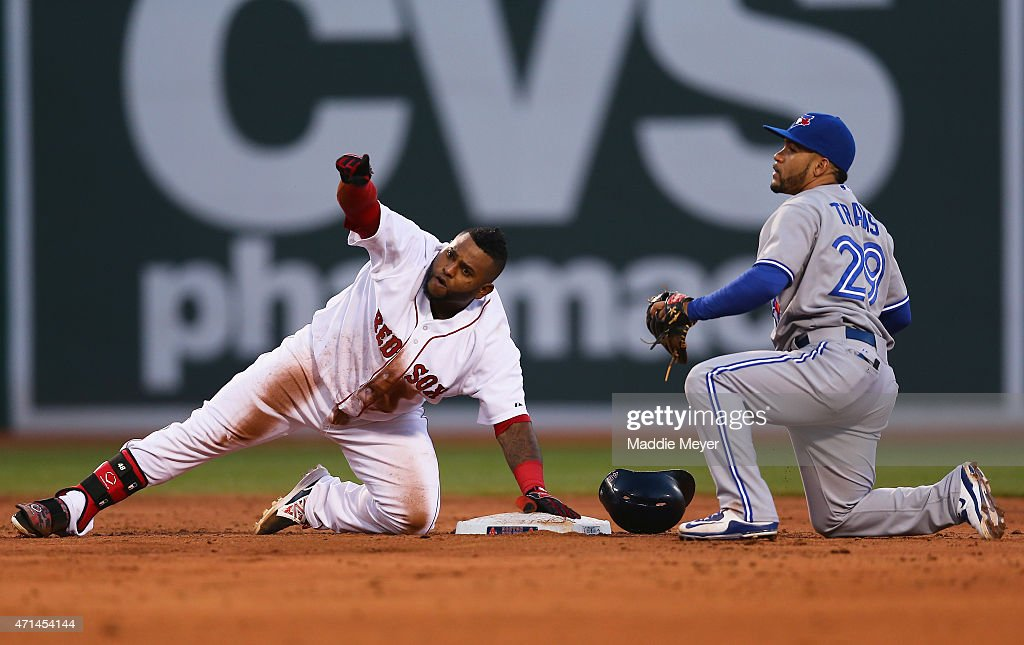 Pablo Sandoval #48 of the Boston Red Sox slides safely into second past Devon Travis #29 of the Toronto Blue Jays during the third inning at Fenway Park on April 28, 2015 in Boston, Massachusetts.