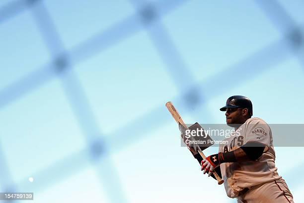 Pablo Sandoval of the San Francisco Giants applies pine tar to his bat in the on deck circle against the Detroit Tigers during Game Two of the Major...