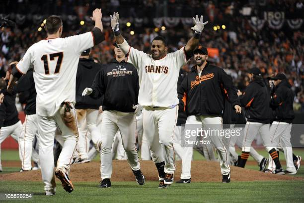 Pablo Sandoval of the San Francisco Giants celebrates after Aubrey Huff scored on a Juan Uribe sacrifice fly to win the game 65 over the Philadelphia...