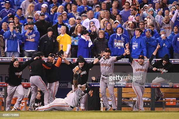 Pablo Sandoval of the San Francisco Giants celebrates after catching the final out to defeat the Kansas City Royals in Game 7 of the 2014 World...