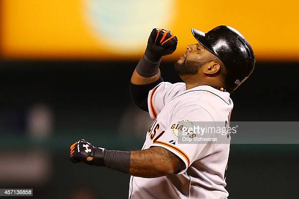 Pablo Sandoval of the San Francisco Giants celebrates after hitting a double in the sixth inning against the St Louis Cardinals during Game Two of...