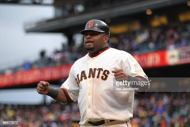 Pablo Sandoval of the San Francisco Giants celebrates after scoring on a Mark DeRosa single in the sixth inning against the Atlanta Braves during an...