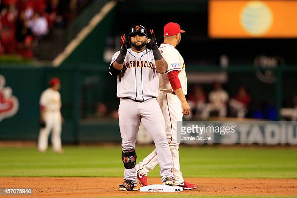 Pablo Sandoval of the San Francisco Giants celebrates on second base after hitting a double in the second inning against the St Louis Cardinals...
