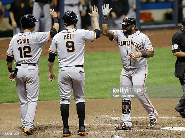 Pablo Sandoval of the San Francisco Giants celebrates with Brandon Belt and Joe Panik after hitting a three run homer in the sixth inning against the...