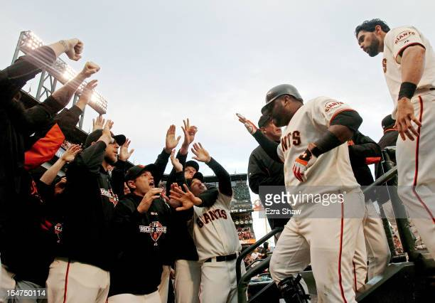 Pablo Sandoval of the San Francisco Giants celebrates with his teammates in the dugout after hitting a solo home run to center field against Justin...