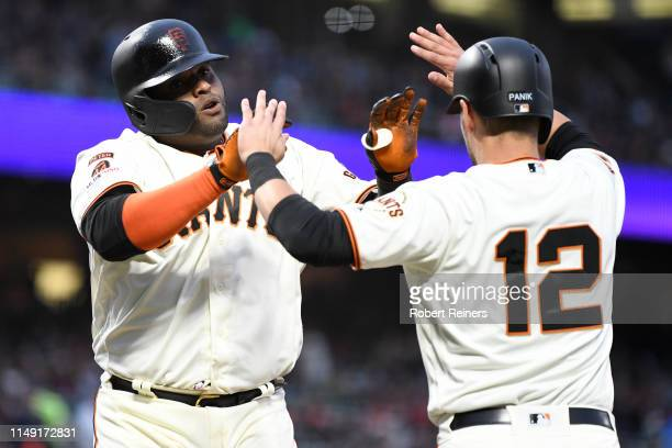 Pablo Sandoval of the San Francisco Giants celebrates with Joe Panik after his tworun home run against the Toronto Blue Jays in the third inning of...