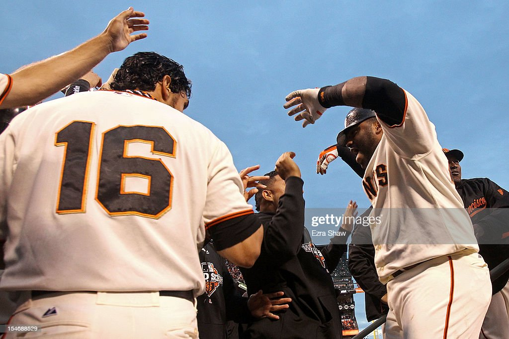 Pablo Sandoval #48 of the San Francisco Giants celebrates with teammate Angel Pagan #16 after scoring a two run home run to left field against Justin Verlander #35 of the Detroit Tigers in the third inning during Game One of the Major League Baseball World Series at AT&T Park on October 24, 2012 in San Francisco, California.