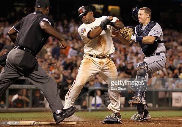 Pablo Sandoval of the San Francisco Giants collides with catcher Nick Hundley of the San Diego Padres in fifth inning at ATT Park on August 23 2011...