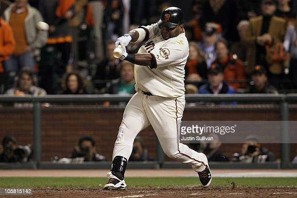 Pablo Sandoval of the San Francisco Giants hits a double in the sixth inning against the Philadelphia Phillies in Game Four of the NLCS during the...