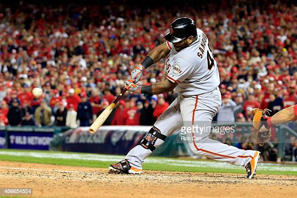 Pablo Sandoval of the San Francisco Giants hits a doubled to left field scoring Joe Panik in the ninth inning against Drew Storen of the Washington...