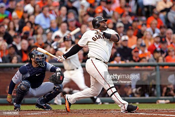 Pablo Sandoval of the San Francisco Giants hits a solo home run to center field against Justin Verlander of the Detroit Tigers in first inning during...