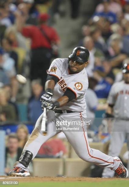Pablo Sandoval of the San Francisco Giants hits a two RBI double in the fifth inning against the Los Angeles Dodgers at Dodger Stadium on September...