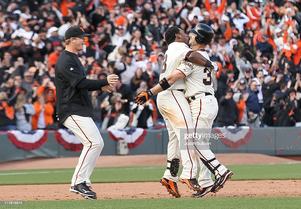 Pablo Sandoval #48 of the San Francisco Giants hugs teammate Aaron Rowand #33 after Rowand drove in the game-winning run during the twelfth inning against the St. Louis Cardinals at AT&T Park on April 8, 2011 in San Francisco, California. The Giants beat the Cardinals 5 to 4.