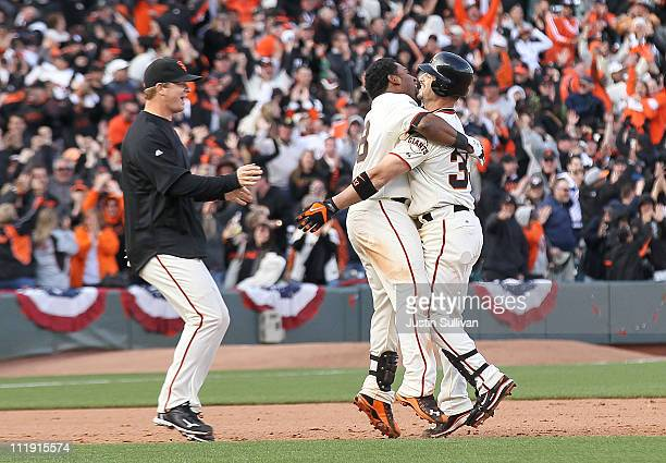 Pablo Sandoval of the San Francisco Giants hugs teammate Aaron Rowand after Rowand drove in the game-winning run during the twelfth inning against...