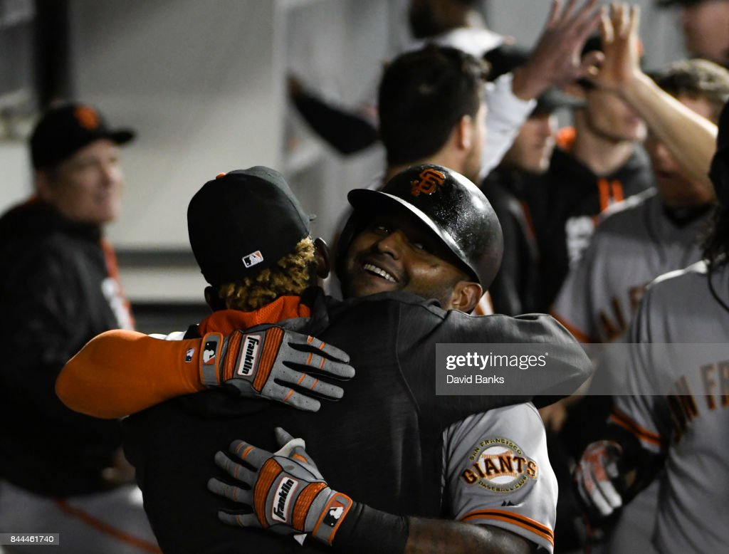 Pablo Sandoval (C) of the San Francisco Giants is greeted by his teammates after hitting a three-run homer against the Chicago White Sox during the fourth inning on September 8, 2017 at Guaranteed Rate Field in Chicago, Illinois.
