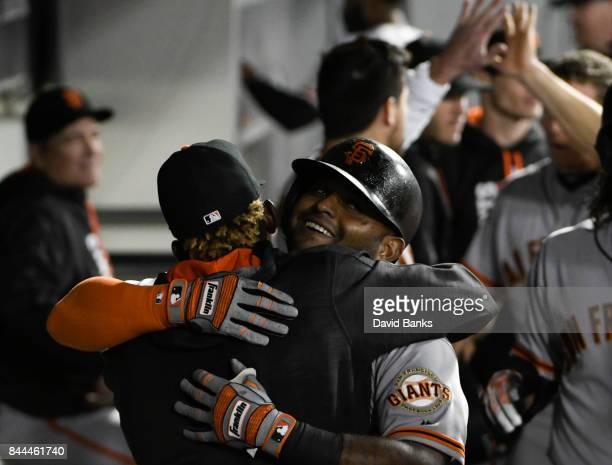 Pablo Sandoval of the San Francisco Giants is greeted by his teammates after hitting a threerun homer against the Chicago White Sox during the fourth...