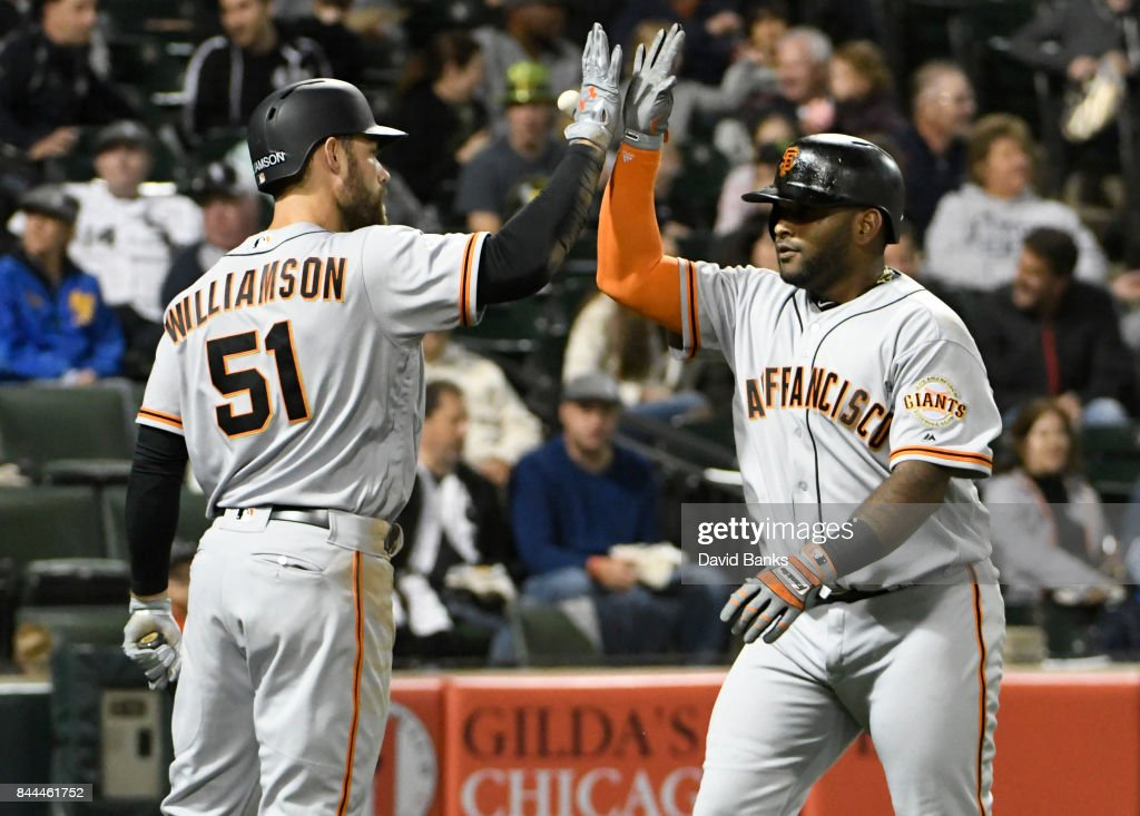 Pablo Sandoval #48 of the San Francisco Giants is greeted by Mac Williamson #51after hitting a three-run homer against the Chicago White Sox during the fourth inning on September 8, 2017 at Guaranteed Rate Field in Chicago, Illinois.
