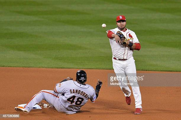 Pablo Sandoval of the San Francisco Giants is out at second base by Jhonny Peralta of the St. Louis Cardinals in the fifth inning during Game One of...