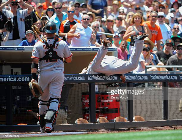 Pablo Sandoval of the San Francisco Giants reaches over the railing for a foul ball hit by Jesus Guzman of the San Diego Padres during the second...