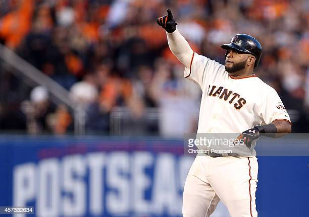 Pablo Sandoval of the San Francisco Giants reacts after a fourth inning double while taking on the St Louis Cardinals during Game Five of the...