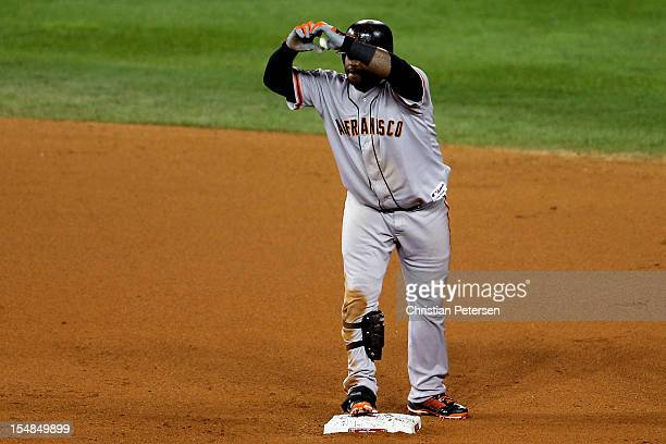 Pablo Sandoval of the San Francisco Giants reacts after he hits a double to deep left field against Joaquin Benoit of the Detroit Tigers in the...