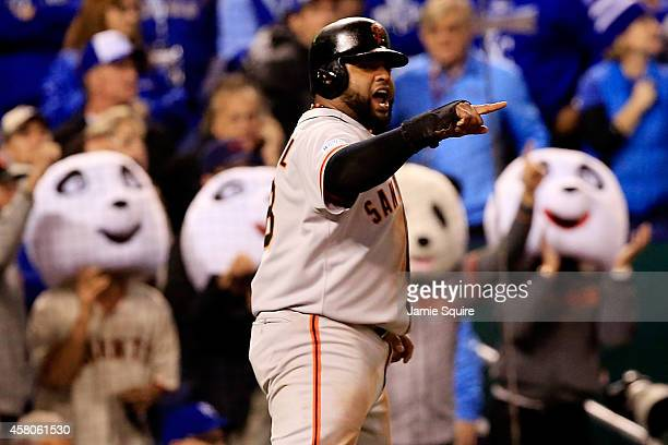 Pablo Sandoval of the San Francisco Giants reacts after scoring in the fourth inning against the Kansas City Royals during Game Seven of the 2014...