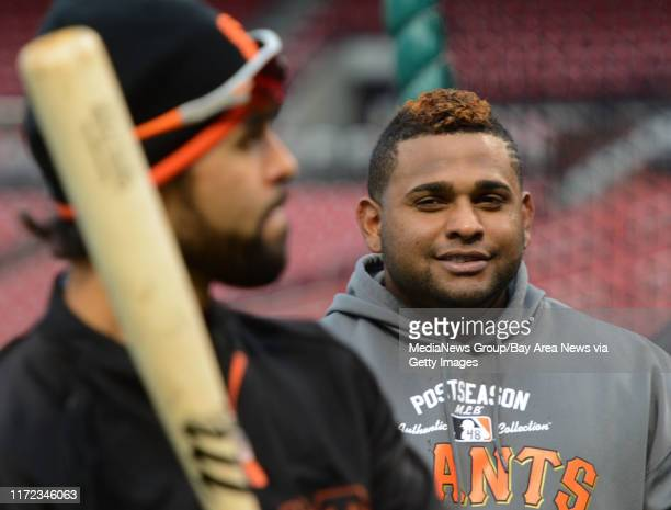 Pablo Sandoval of the San Francisco Giants right jokes around with Angel Pagan during batting practice before Game 5 of the National League...