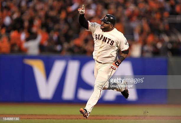 Pablo Sandoval of the San Francisco Giants rounds the bases after scoring a two run home run to left field against Justin Verlander of the Detroit...