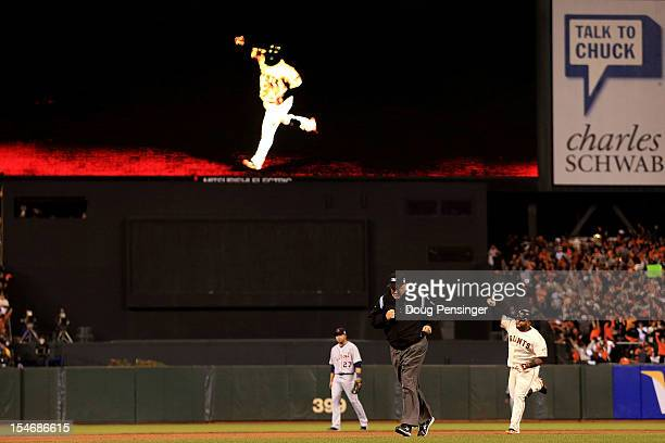 Pablo Sandoval of the San Francisco Giants rounds the bases after hitting a solo home run to center field against Al Alburquerque of the Detroit...