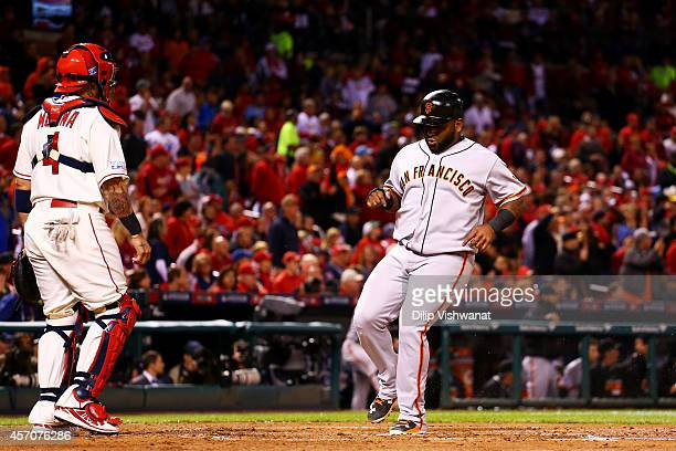 Pablo Sandoval of the San Francisco Giants runs home to score on an RBI single by Travis Ishikawa in the second inning against the St Louis Cardinals...