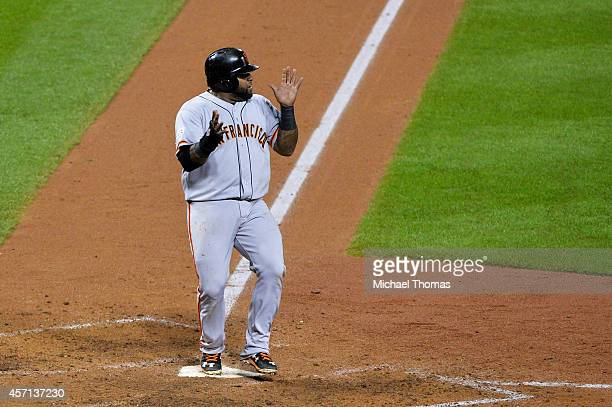 Pablo Sandoval of the San Francisco Giants runs home to score on single by Hunter Pence in the sixth inning against the St Louis Cardinals during...