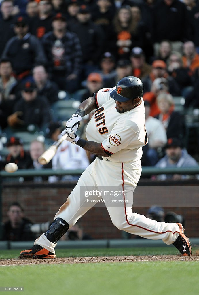Pablo Sandoval #48 of the San Francisco Giants singles home Aaron Rowand in the 9th inning to tie the game 4-4 against the St. Louis Cardinal at AT&T Park April 8, 2011 in San Francisco, California. The Giants won the game in extra innings 5-4.
