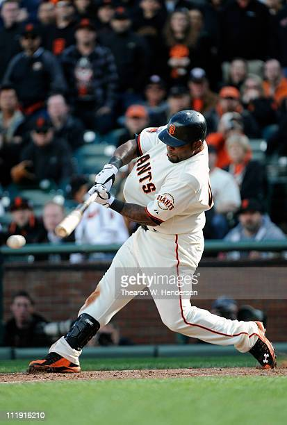 Pablo Sandoval of the San Francisco Giants singles home Aaron Rowand in the 9th inning to tie the game 4-4 against the St. Louis Cardinal at AT&T...