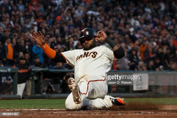 Pablo Sandoval of the San Francisco Giants slides into home plate to score a run against the San Diego Padres during the fifth inning at ATT Park on...