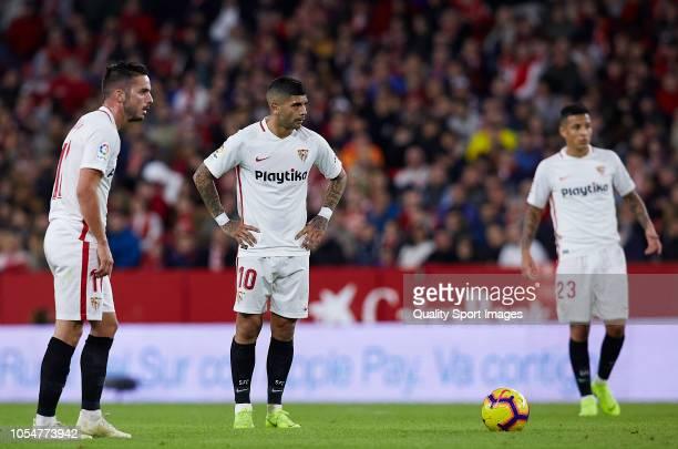 Pablo Sarabia Ever Banega Guilherme Arana of Sevilla look on during the La Liga match between Sevilla FC and SD Huesca at Estadio Ramon Sanchez...