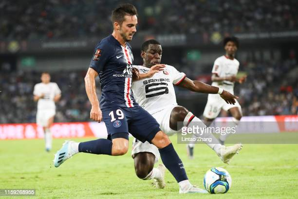 Pablo Sarabia Garciaof Paris SaintGermain competes the ball with Faitout Maouassa Stade Rennais FC during to the 2019 Trophee des Champions between...