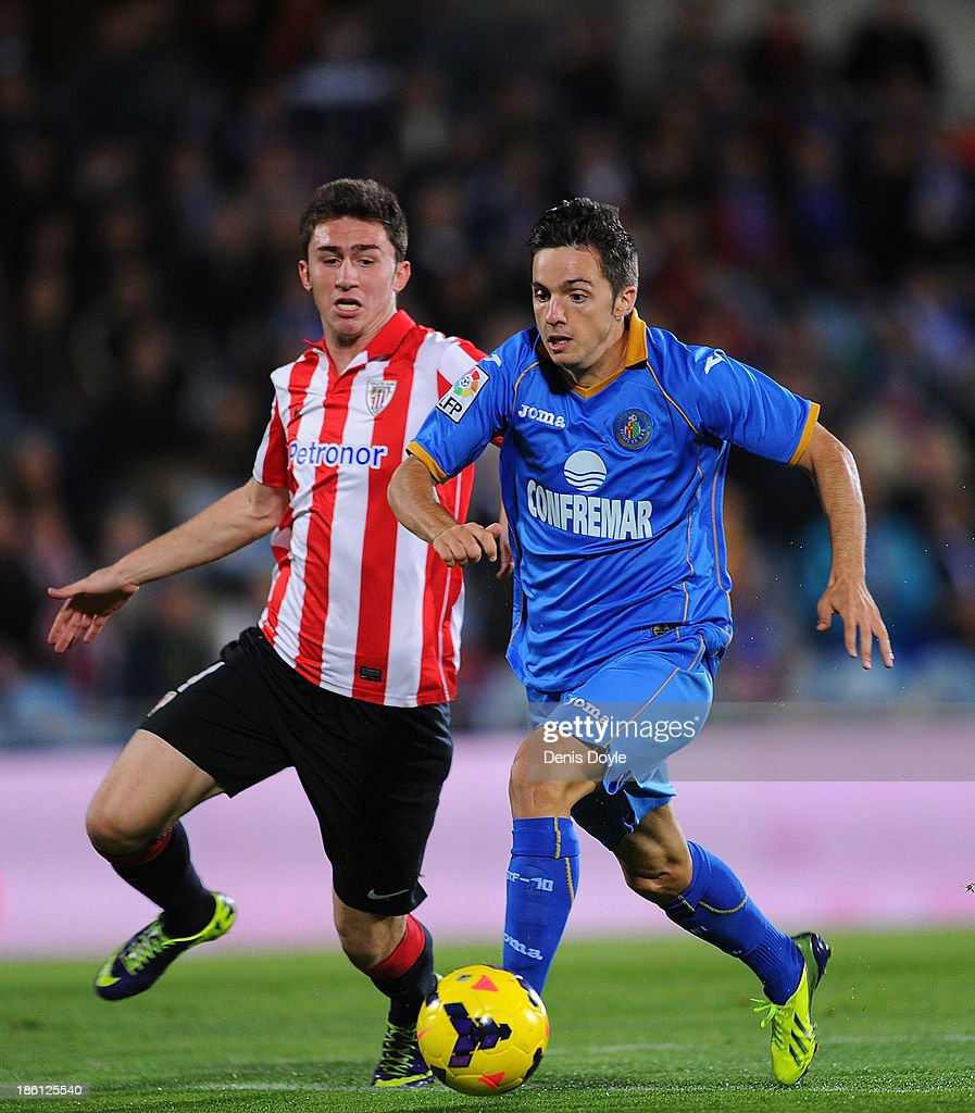 Pablo Sarabia (R) of Getafe is tackled by Aymeric Laporte of Athletic Club during the La Liga match between Getafe CF and Athletic Club at Coliseum Alfonso Perez stadium on October 28, 2013 in Getafe, Spain.