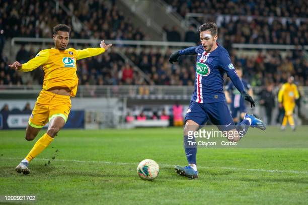 January 29: Pablo Sarabia of Paris Saint-Germain beats the challenge of Younn Zahary of Pau to score his sides second goal during the Pau V Paris...
