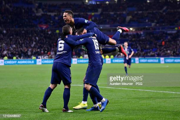 Pablo Sarabia of Paris Saint-Germain is congratulated by teammate Thilo Kehrer after scoring during the French Cup Semi Final match between Olympique...